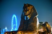 LONDON, UK - SEP 27: Sphinx statue and London Eye on September 27, 2013 in London, UK. London is the