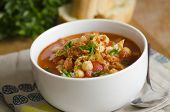 stock photo of chickpea  - Delicious Chorizo chickpea and cabbage soup in a bowl - JPG