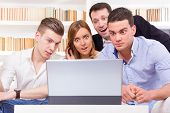 image of pissed off  - pissed off casual group of friends because results looking on laptop computer - JPG