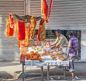 Man Selling Religious Offerings And Decoration At Chawri Bazar In Delhi, India