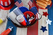 High angle photo of a picnic table ready for Fourth of July Party. The red white and blue table is s