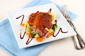 stock photo of duck breast  - Roasted duck breast vegetables and cutlery top view - JPG