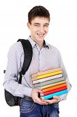 stock photo of knapsack  - Student with Knapsack Holding the Books Isolated on the White Background - JPG