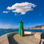 Javea Xabia green lighthouse beacon at Port in Alicante Mediterranean Spain