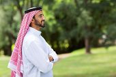 cute arabian man with arms crossed looking away