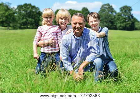 Happy Family Having Fun At Outdoors