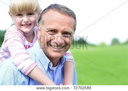 Happy Father And Daughter At Outdoors