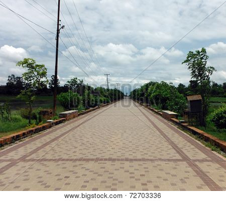 Broad Empty Pavement At Off-season Lumbini
