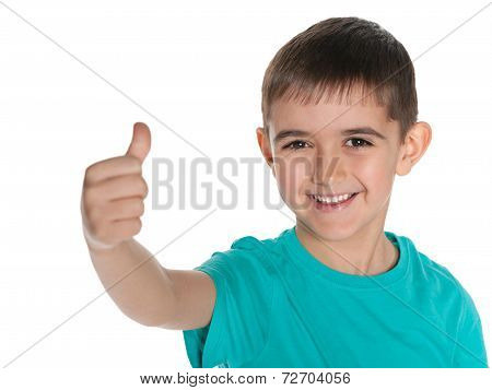 Young Laughing Boy Holds His Thumb Up