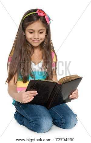 Smiling Young Girl Reads An Old Book