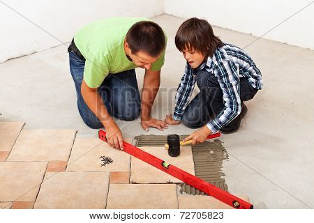 Man And Boy Laying Ceramic Floor Tiles