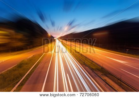 Highway With Light Trails At Dusk In Blurred Motion