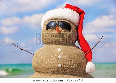 Snowman Made Out Of Sand Against Sky. New Year  and Christmas Concept.