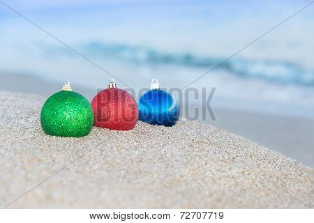 Christmas Tree Decorations On Sea Beach Background