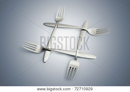 Four Interlaced Silver Forks On Blue Gradiant