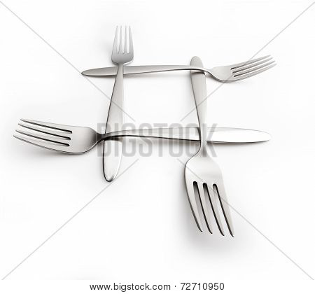 Four Interlaced Silver Forks On Wide Background With Wide Angle