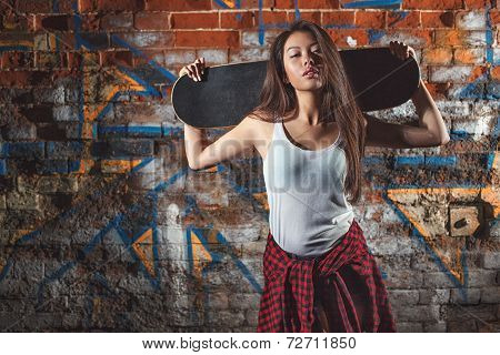teen girl with skate board