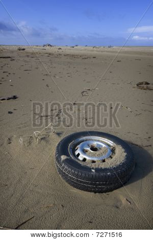 Old Tire Washed Up On Shore