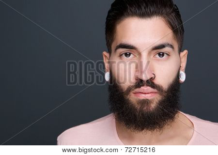 Young Man With Beard And Piercings
