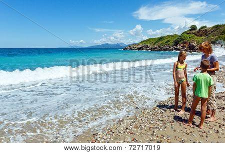 Family On Summer Beach (greece, Lefkada).