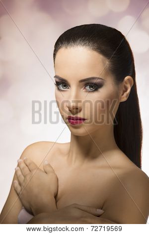 Brunette Girl With A Ponytail Looking In Mamera