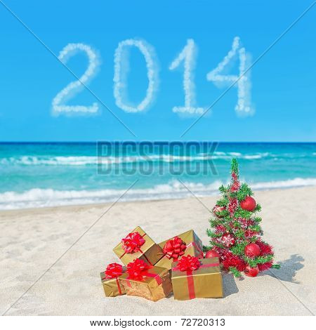 Christmas Tree And Gift Boxes On Sea Beach. Concept For New Year 2014.