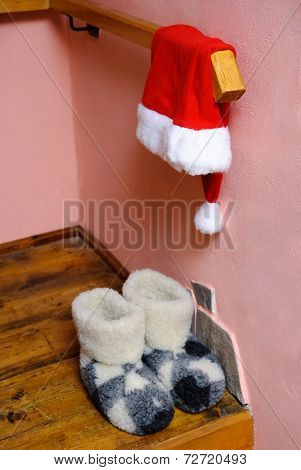 Red Santa Hat And Warm Woolen  Boots At Home Interior