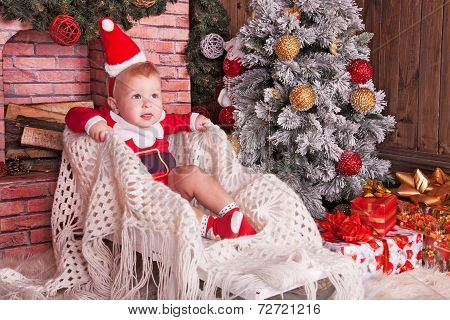Happy Small Child In Santa Hat With Christmas Gift Box