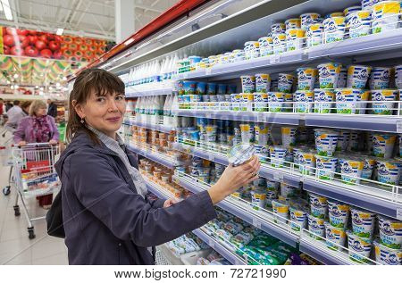 Samara, Russia - September 23, 2014: Young Woman Choosing Fresh Milk Produces At Shopping In Dairy S