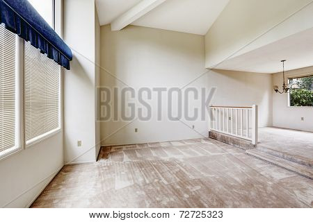 Empy House Interior With High Vaulted Ceiling And Carpet Floor