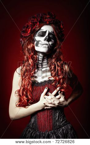 Sad Young Woman With Halloween Make Up Holding Her Chest
