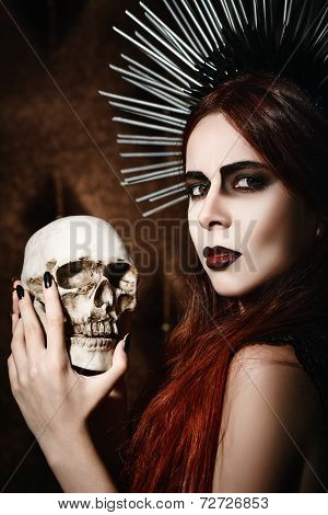Portrait Of Beautiful Gothic Girl Holding The Skull