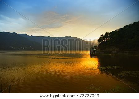 Evening Landscape With Lake And Mountains