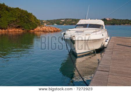 Boat At A Pier On Sardinia Island