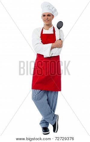 Young Chef Posing In Style With Kitchen Utensils