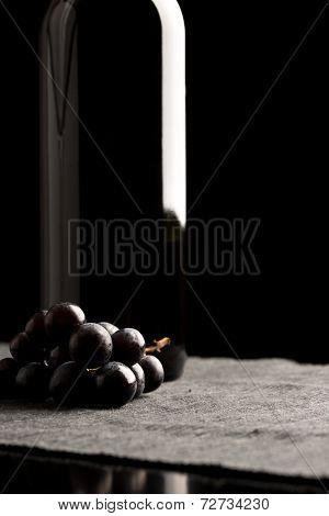Bunch Of Black Grapes With A Wine Bottle