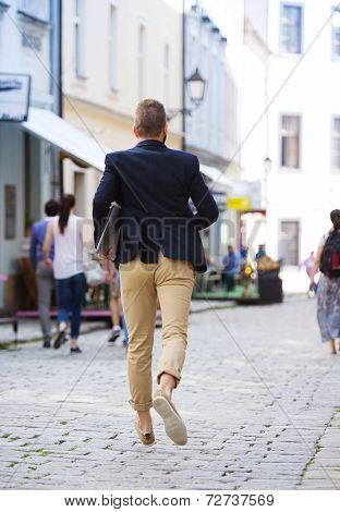 Hipster businessman hurrying