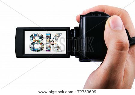 Hand Holding Ultra High Definition Camcorder Isolated On White