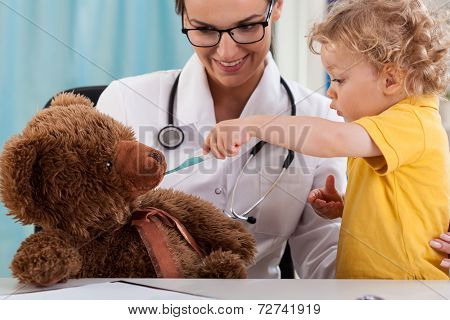 Child Taking Temperature Of Teddy Bear