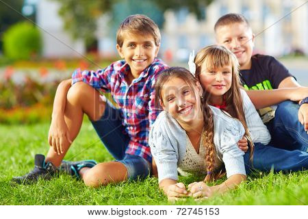 Happy Schoolkids Playing In The Park