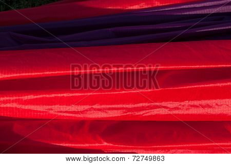 Closeup of red balloon fabric