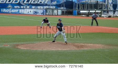Citadal Pitcher Fires A Ball Towards Homeplate