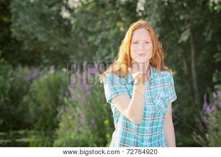 Woman Sending An Air Kiss