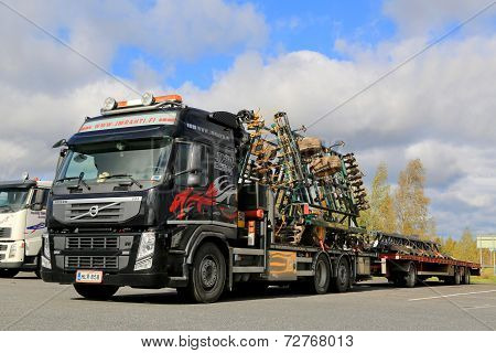 Volvo FM 460 Truck Hauls Multiva Seedbed Cultivator