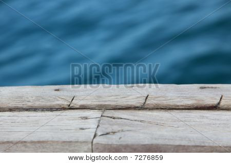 Old Wooden Pier Over The Water