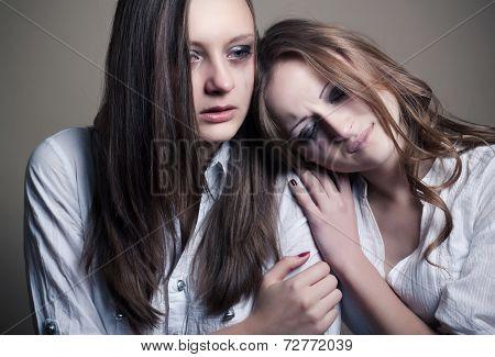 two young girls crying, studio shoot