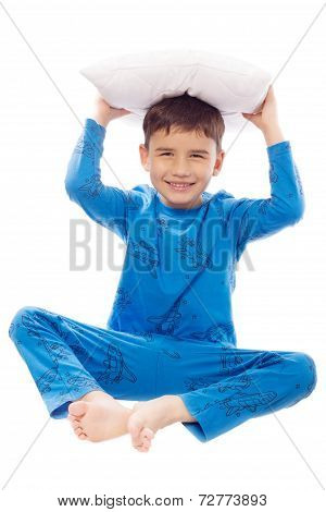 Boy In Pajamas With A Pillow