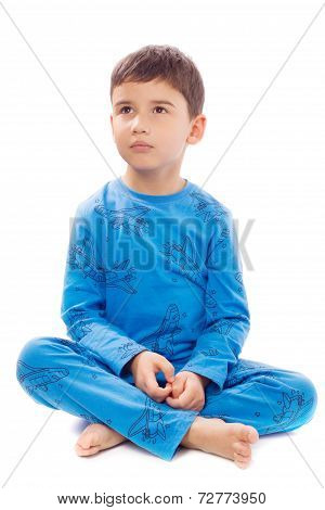 Boy In Pajamas On White Background