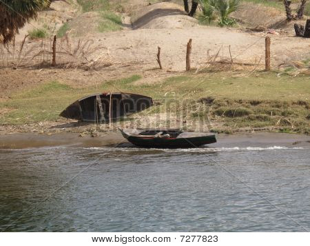 Two Canoes On The Shore Of The Nile River