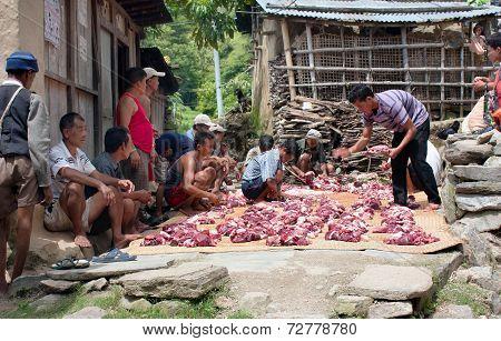 Nepalese Who Cutting Yak Or Buffalo Meat.